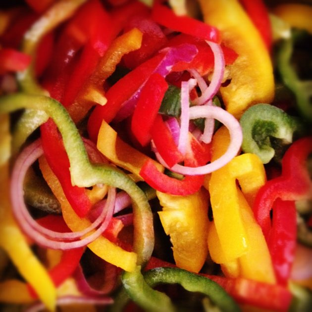 sliced red, green, and yellow peppers