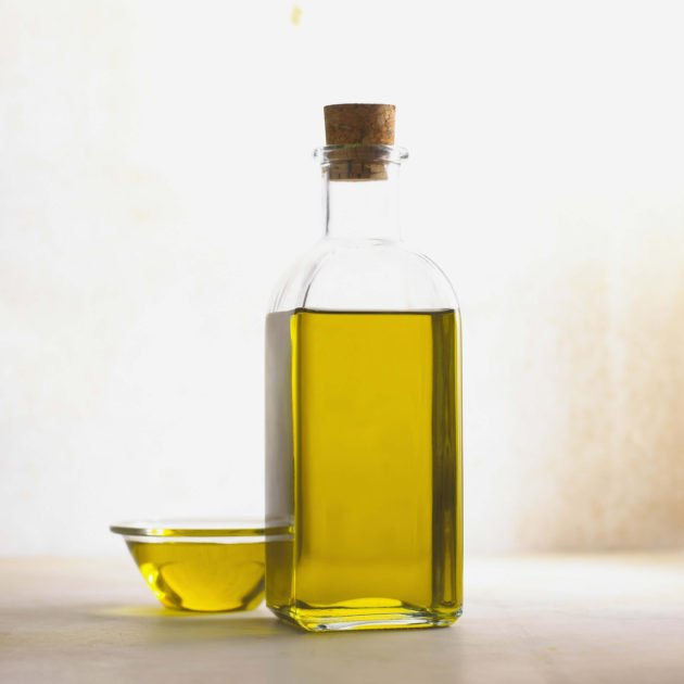 olive oil in a body and a dish on a countertop
