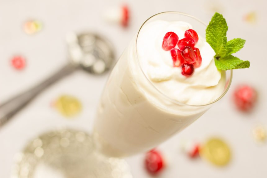 yogurt in a glass with berries on top