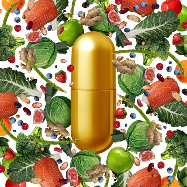 vitamin pill in the middle of vegetable background