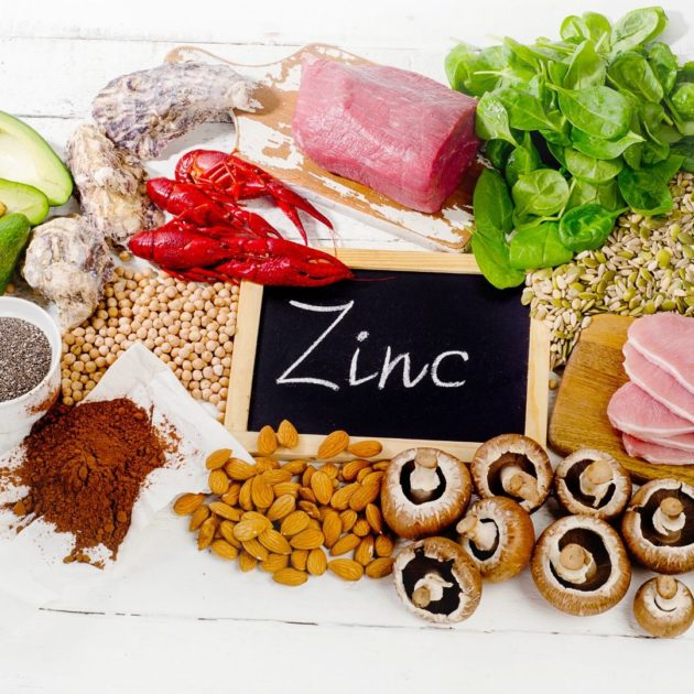 Zinc containing foods on a white background
